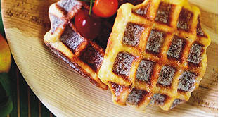 wooden plates with waffles on them